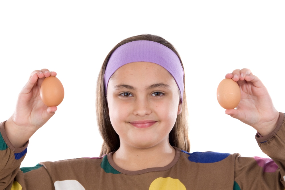 Adorable girl with two eggs on his hands