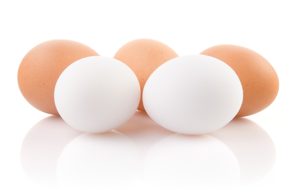 Five eggs isolated on white background
